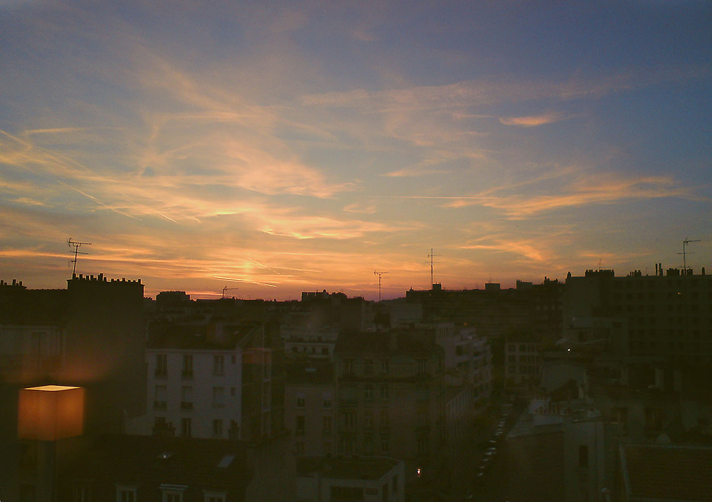 Sunset over rooftops in Paris