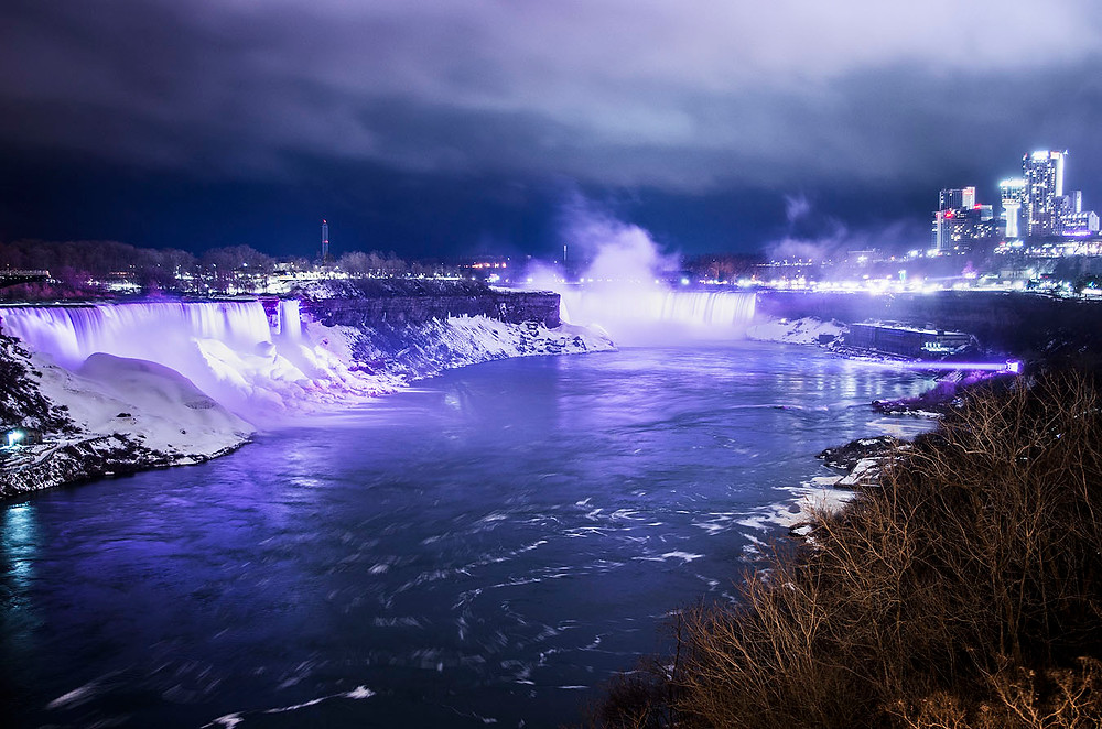 Niagara Falls in winter lit up at night