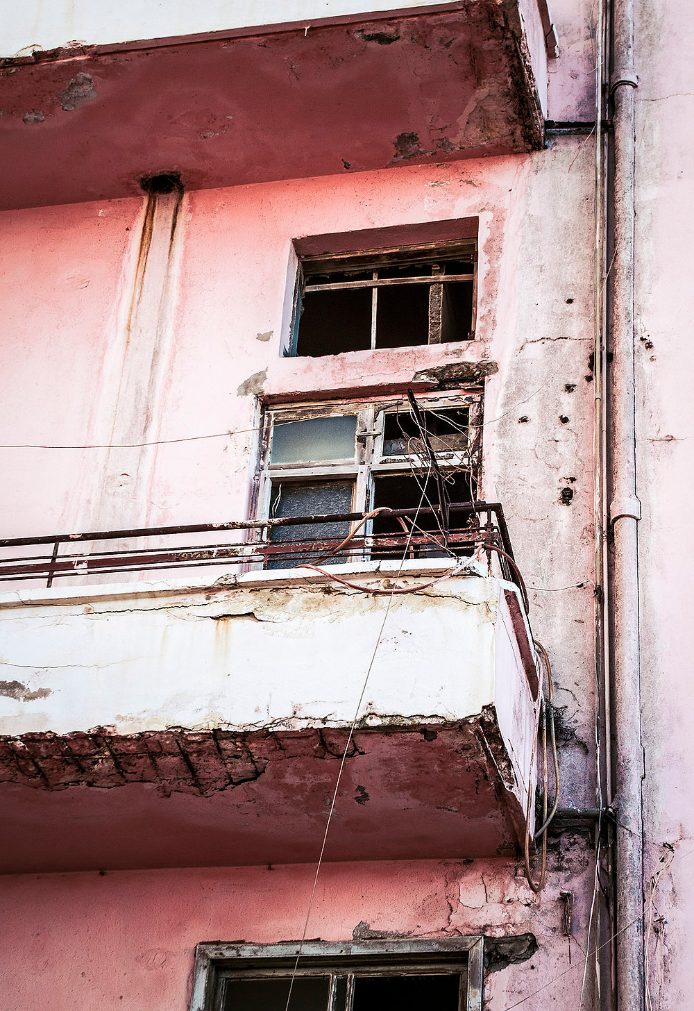 Damaged pink building in Manara, Beirut