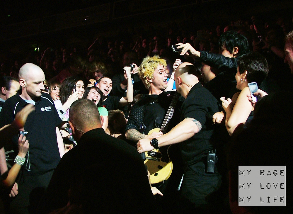 Green Day's Billie Joe Armstrong with seated fans in Manchester