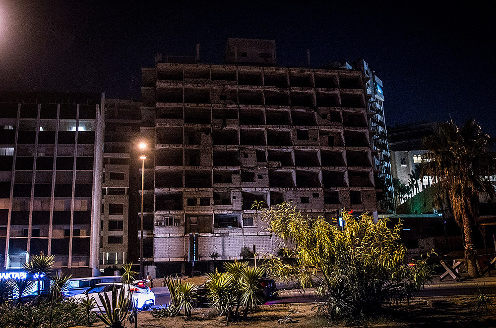 Damaged building in Beirut at night