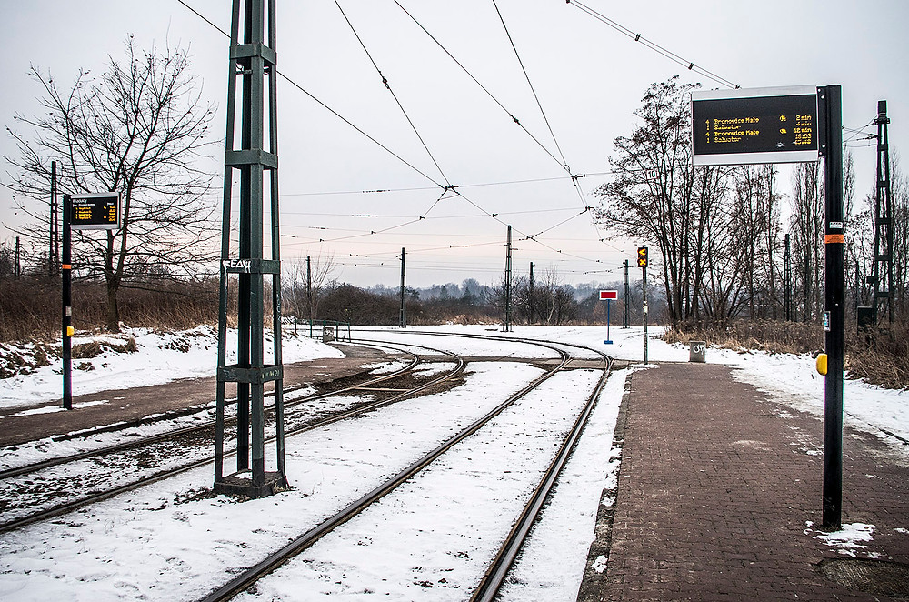 Snow at a tram stop in Krakow, Poland