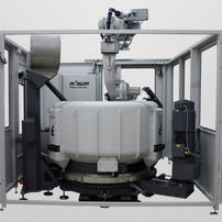 Surf Finisher with 6 axis jointed arm robots to dip the pieces in the rotating container.