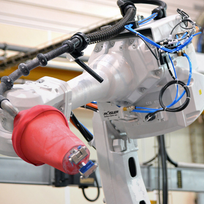 Detail view of the robot gripping arm