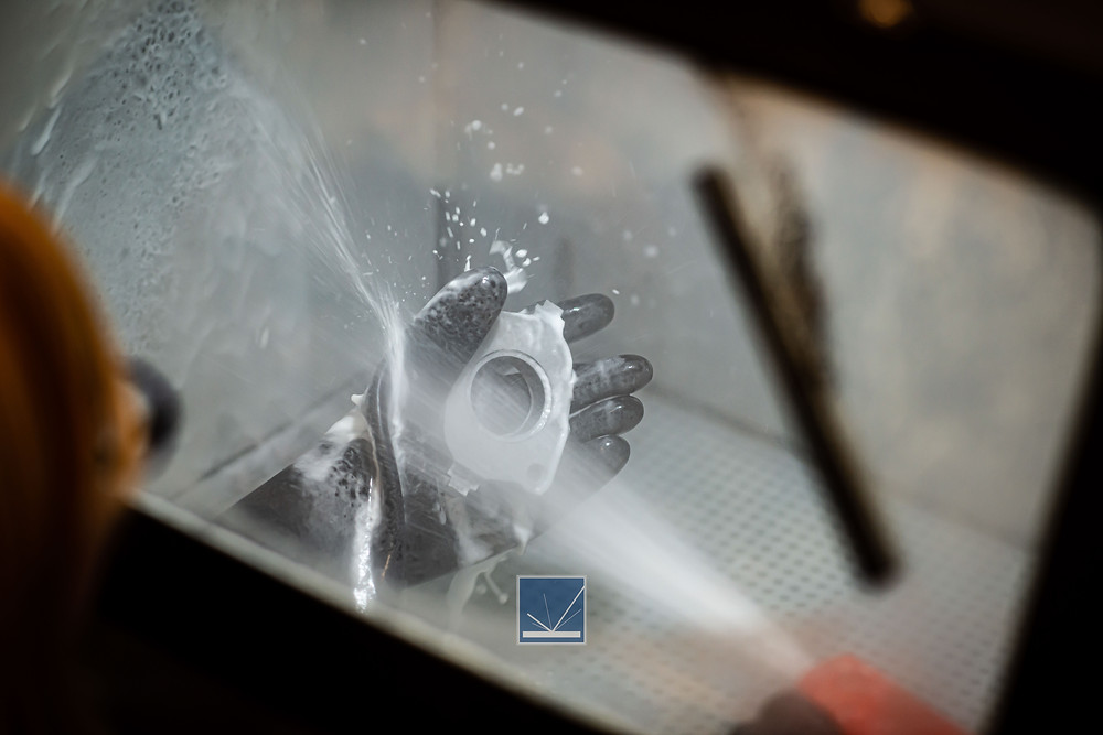 Wetblasting a powdered metal part for surface finish and inhabitation | Precision Finishing Inc.