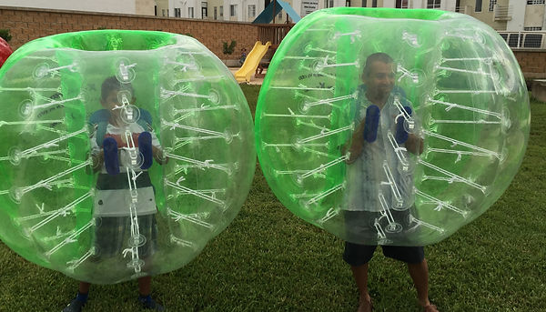 Father & Son Playing Bubble Soccer