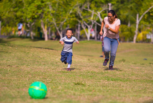 Mum playing football