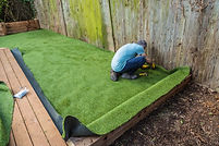 Artificial grass being installed, added