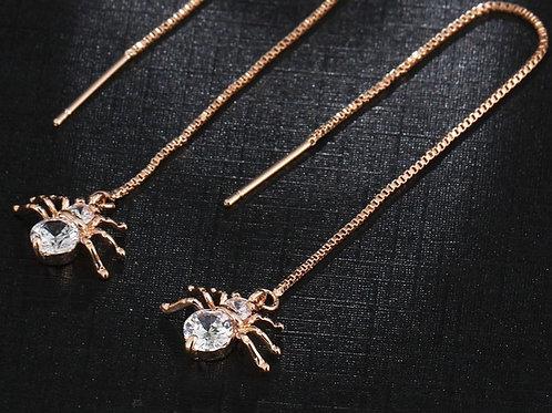 Spider string earrings rose gold