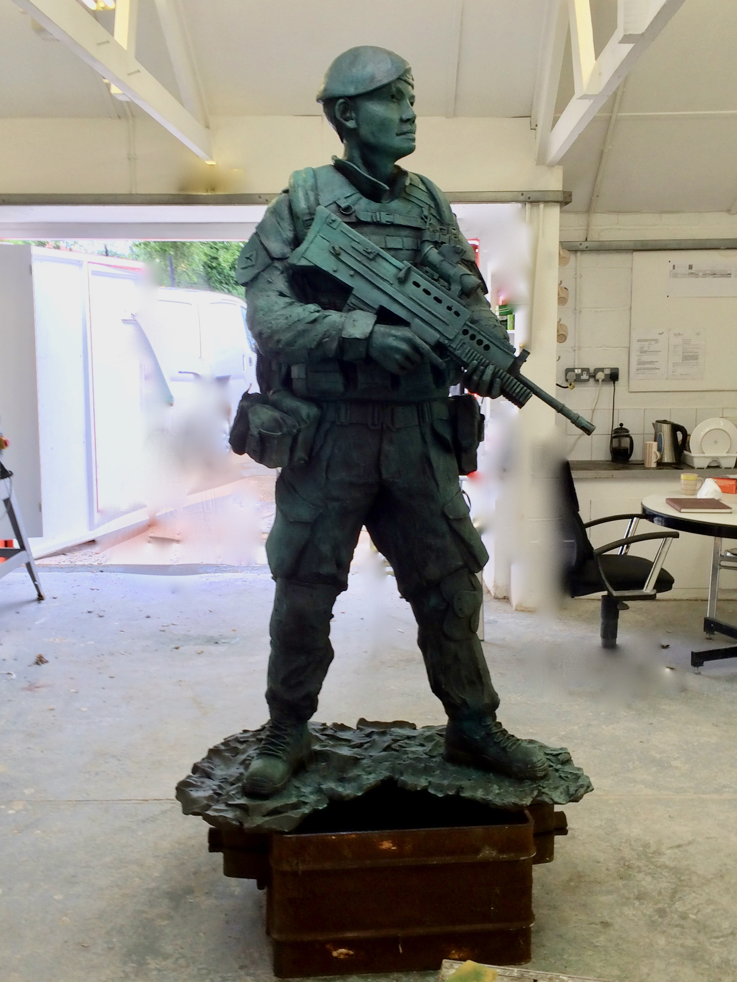 The patinated bronze