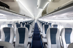 Commercial aircraft cabin with rows of s