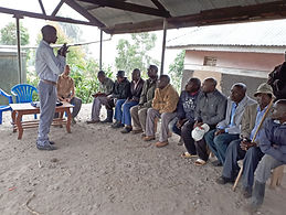 Meeting with local leaders to explain the antimicrobial resistance project around Mgahinga National Park.