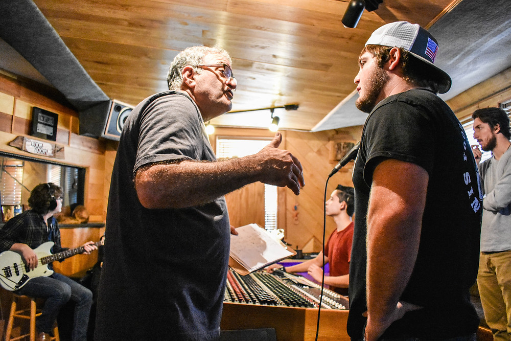 Jay Vernali (producer and studio owner) talking with Rhett while Sam, Javier, and John work in the background.
