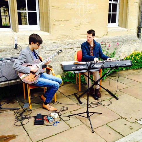 John performing with guitarist Julian Woods at an event at Corpus Christi College, University of Oxford