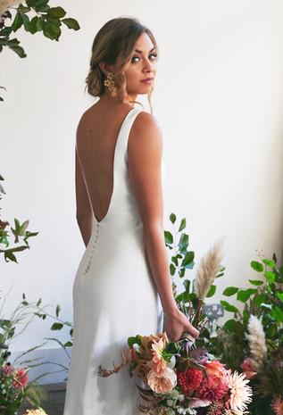 Issy wearing The Own Studio bridal dress.