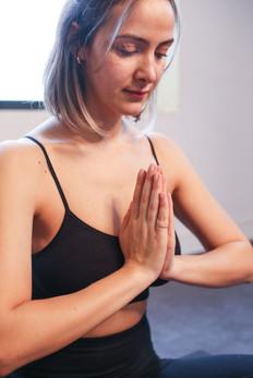 Anastasia practising yoga