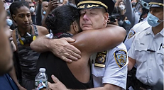 A thankful moment - protestor hugging a policeman