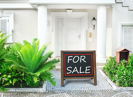 Real estate sign in front of new house f