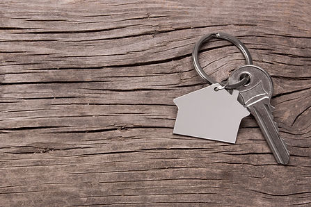 Key and keychain in the shape of a house