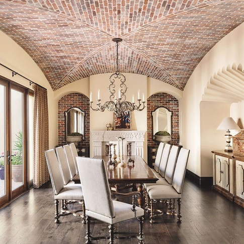 Brick vaulted-ceiling Dining Room