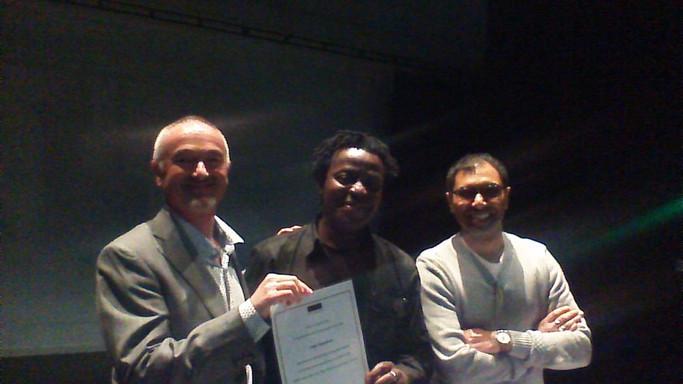John Akomfrah, 2016 (pictured with Phil Powrie & Rajinder Dudrah)