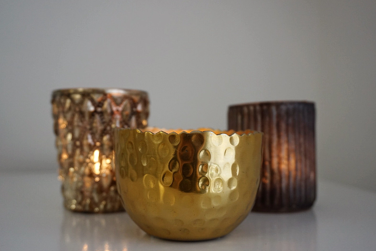 this stylish and modern gold tea light holder from paisley and gold will look perfect in any room around the house itu0027s stunningly reflective with a lit