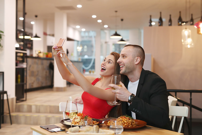 couple-making-selfie-restaurant.jpg