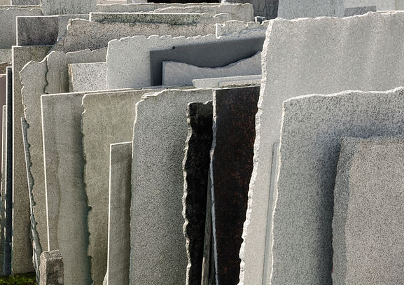 Row of natural stone panels in a mason's