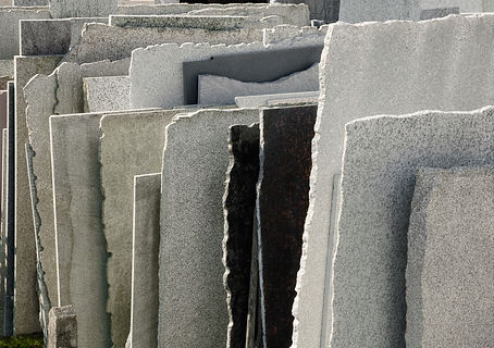 Row of natural stone panels in a mason's yard