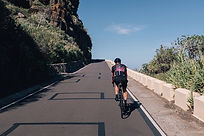 A cyclist on a mountain road small.jpeg