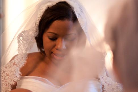 Hazy image taken through the bride's veil as she gazes in the mirror.