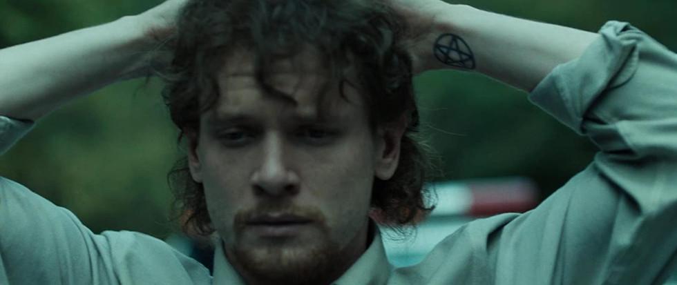 Captive State, wrist tattoo
