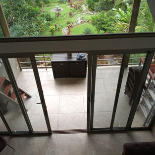 Looking down to outside seating area from bedroom
