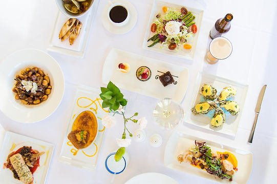 tabletop of food dishes and beverages