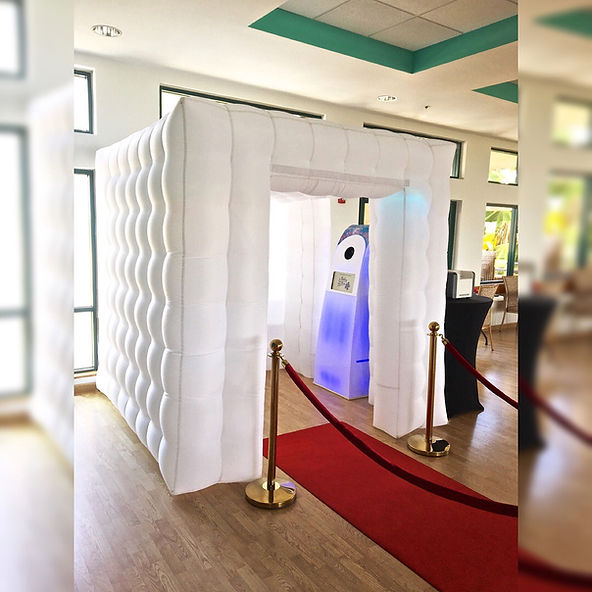 Elegant white party cube photo booth with red carpet. Photo Booth Rentals