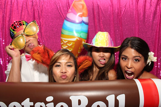 photo booth picture with props and pink sequin background