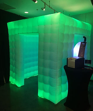 Green glowing party cube photo booth at event