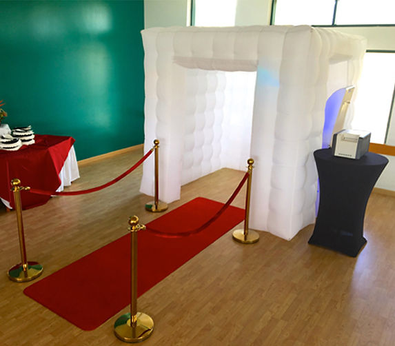 Elegant white party cube photo booth with red carpet
