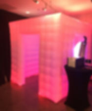 Glowing party cube photo booth at event