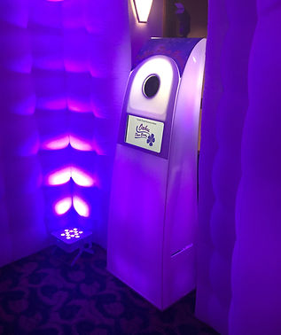 Glowing purple party cube photo booth