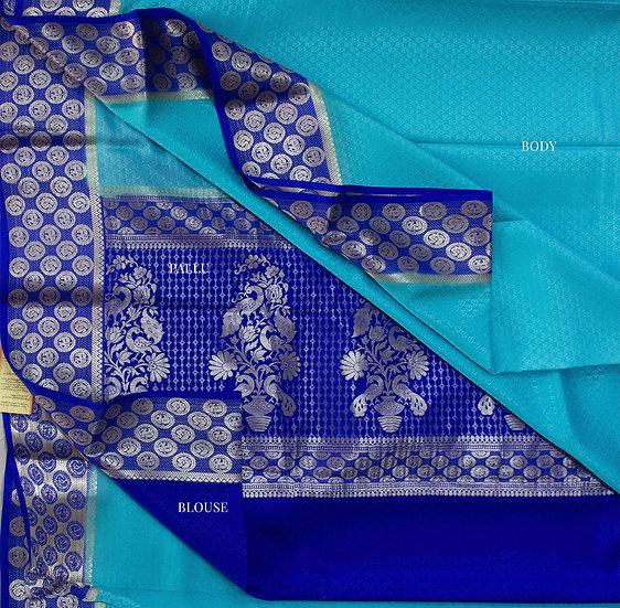 Sky blue with 1000 dollar motifs border and Rich pallu