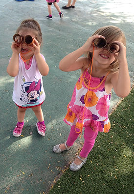 Preschool students playing on campus.