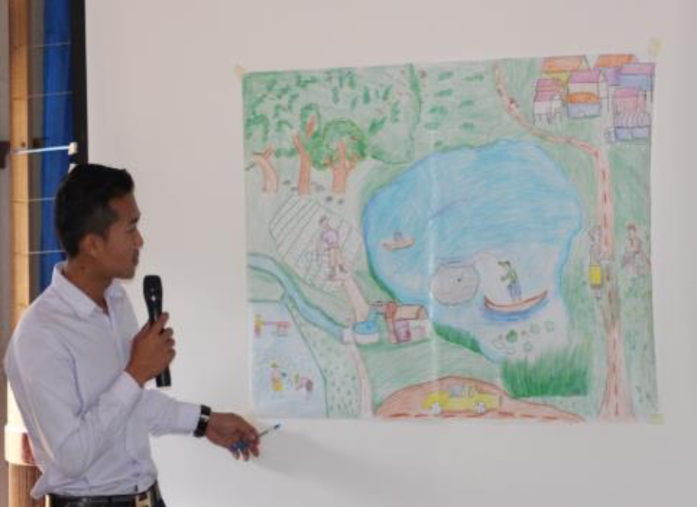 Student presents his drawing during World Wetlands Day celebrations