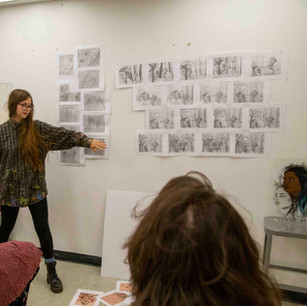 Welcome to my page! This gallery shows a few selected works, and more information about each project can be found underneath my media specific tabs.    Here is a candid photo of me showing iterations of a drawing during a critique!