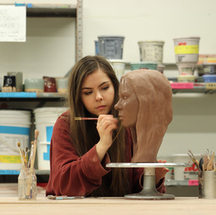 Welcome to my page! This gallery shows a few selected works, and more information about each project can be found underneath my media specific tabs.   Here, I am working on my ceramic life-size self portrait bust. More information about this can be found under the Ceramics tab!