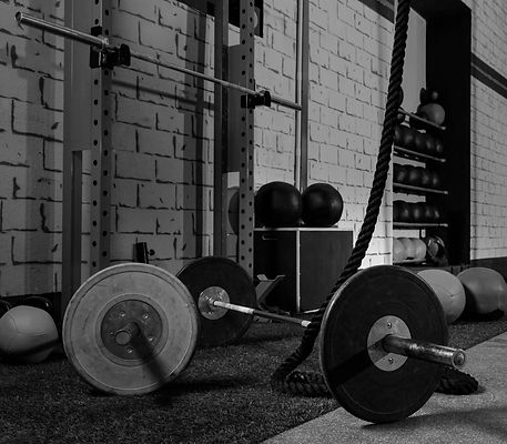 Barbells in a gym bar bells and rope at
