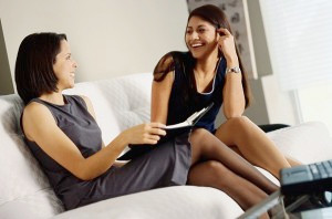 Businesswomen Sitting with Binder