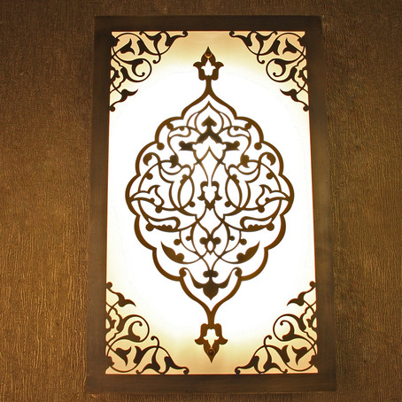 Calligraphy. Where did it come from? How did it find it's way to the designing of lamps?