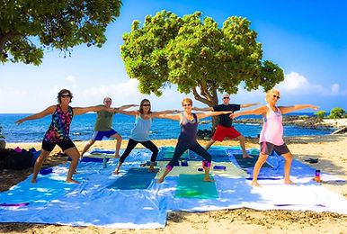 Beautiful morning for yoga on the beach in Hawaii men and women