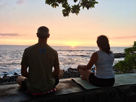 Sea wall meditation over ocean at sunset
